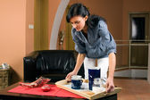 Young woman working in living-room — Stock Photo