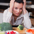 Sad woman in kitchen - Stock Photo
