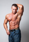Handsome shirtless man - gray background — Stock Photo