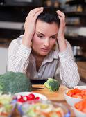 Sad woman in kitchen — Stock Photo