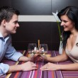 Young couple drinking wine and flirting — Stock Photo #7600018