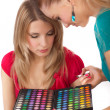 Make-up girl showing range of collors — Stock Photo