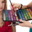 Make-up girl showing range of collors — Stock Photo #7600792
