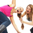 Stock Photo: Two young womin conflict