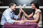 Attractive couple drinking wine — Stock Photo
