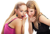 Two young woman wispering secrets — Stock Photo