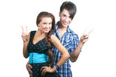 A young happy couple showing thumbs up. — Stock Photo