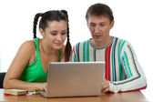 Young couple with computer — Stock Photo