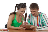 Young couple with computer tablet — Stock Photo