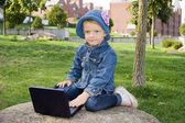 The girl in the park with a portable video player — Stock Photo