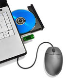Laptop with open compact disc tray,USB flash drive and mouse — Stock Photo