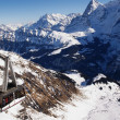 Stock fotografie: High Alpine mountains under snow in winter and cable car.