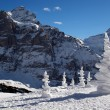 Foto Stock: Alps with snow pyramids in winter day.