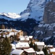 Foto Stock: Alpine Village in winter day.