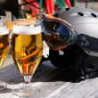 Royalty-Free Stock Photo: Glasses of beer and a ski helmet