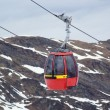 Foto Stock: Red cable car in Alps