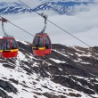 Foto Stock: Two red cable cars in Alps
