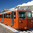Train at railway station in Alps. — Stock Photo