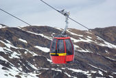 Red cable car in Alps — Stock Photo