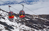 Two red cable cars in Alps — Stock Photo