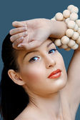 Beautiful woman with coral lipstick — Stock Photo
