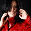 Woman in red leather jacket. - Stock Photo
