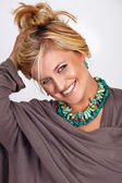 Blond smiling tanned woman — Stock Photo