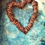 Grunge heart on blue wall — Stock Photo