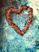 Grunge heart on blue wall — Stock Photo