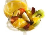 Mixed fruit salad and orange juice — Stock Photo