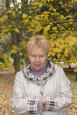 Middle-aged woman in autumn park — Stock Photo