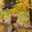 Middle-aged man in autumn park — Stock Photo