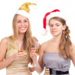 Two girls celebrate Christmas with gifts and glasses in their hands — Stock Photo