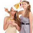 Stock Photo: Two girls celebrate Christmas with gifts and glasses in their hands