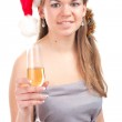 Girl celebrates Christmas with a glass of wine — Stock Photo #7309145