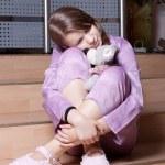 The girl in purple pajamas — Stock Photo