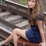Woman sitting on rails — Stock Photo #7579614