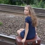 Woman sitting on rails — Stock Photo #7579663