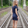 Girl standing on the rails — Stock Photo #7579748