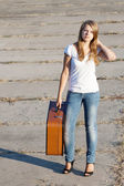 Beautiful girl with a suitcase — Stock Photo