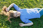 Beautiful girl in the shirt on the grass — Stock Photo