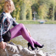 Beautiful girl in purple tights in autumn — Stock Photo