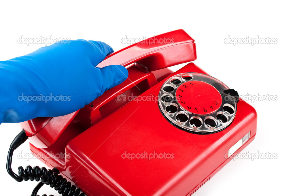 Man in blue gloves picked it up the red phone isolated on a white background — Stock Photo #6821361