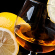 Cognac with lemon in a classic glass — Stock Photo