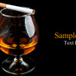 Royalty-Free Stock Photo: Cognac with cigarettes