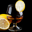 Cognac with lemon in a classic glass — Stock Photo #6835291