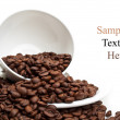 Full cup with coffee beans — Stock Photo