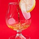 Cognac with lemon — Stock Photo
