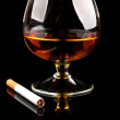 Cognac with cigarettes — Stock Photo