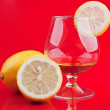 Cognac in a classic glass and lemon — Stock Photo